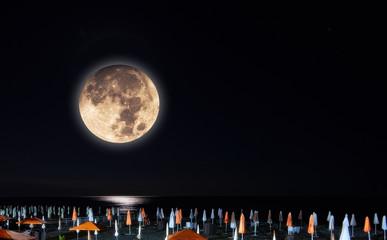 Moon collage of light lane on the Black Sea beach