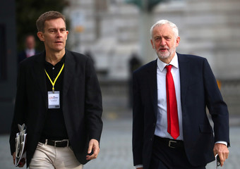 Britain's Labour Party leader Jeremy Corbyn and Seumas Milne, the Labour Party's Executive Director of Strategy and Communications, arrive at the annual Labour Party Conference in Liverpool