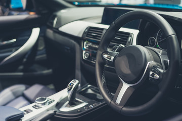 interior of a modern car with steering wheel tone Luxury