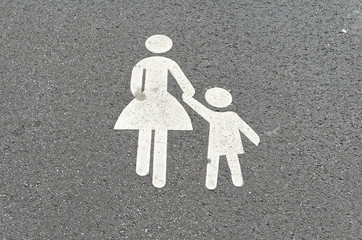 Traffic sign on a bike path. Pedestrian or woman with child to illustrate a pedestrian path