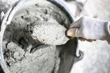 Cement or mortar, Cement powder with a trowel put on the brick at construction work.