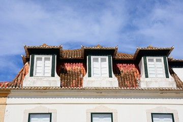 Dormer windows on a traditional Portuguese building along the Av Da Republica, Vila Real de Santo Antonio, Algarve, Portugal.