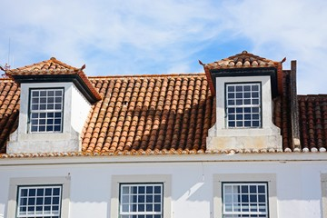 Traditional Portuguese building with dormer windows in the Praca do Marques de Pombal (Marquis of Pombal Square), Vila Real de Santo Antonio, Algarve, Portugal.