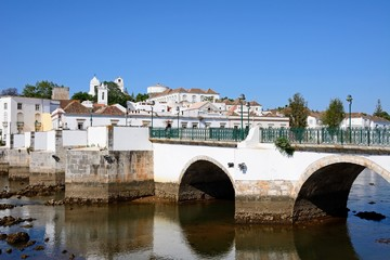 View of the Roman bridge (Ponte Romano) and Gilao river with town buildings to the rear, Portugal.