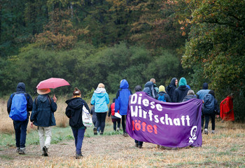 People march against German utility and power supplier RWE near Kerpen-Buir