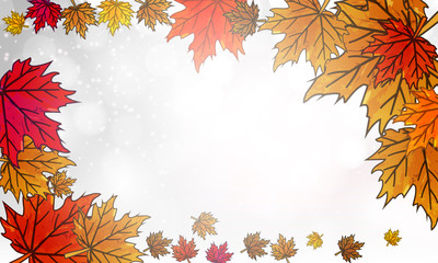 Autumn leaves on a silver bokeh background