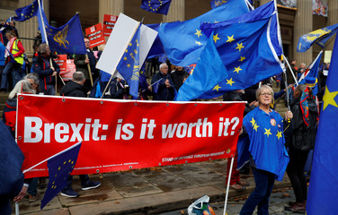 Anti-Brexit supporters demonstrate outside the conference centre at the annual Labour Party Conference in Liverpool