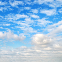 Cumulus clouds in the blue sky.