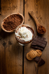 hot chocolate with whipped cream and cookies