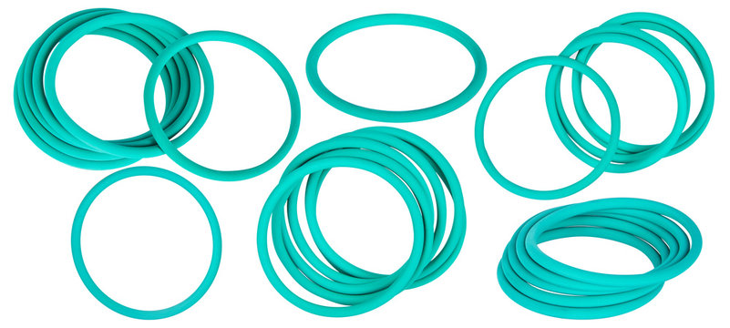 Green hydraulic and pneumatic o-ring seals isolated on white background. Rubber rings. Sealing gaskets for hydraulic joints. Rubber sealing rings for plumbing. Collection of seals