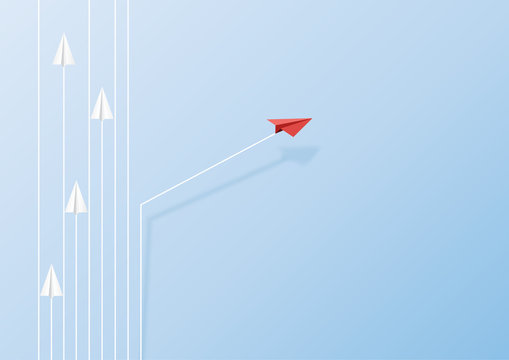 Paper airplanes flying on blue sky and cloud.Paper art style of business teamwork and one different vision creative concept idea.Vector illustration