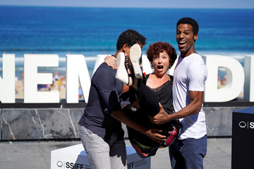 Director Bollain is lifted by actors Acosta and Martinez during a photocall to promote Yuli at the San Sebastian Film Festival
