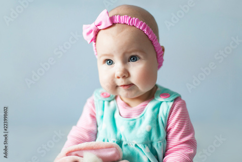 737458a2b Pretty baby girl with sweet cute pink cheeks. Child has blue eyes ...