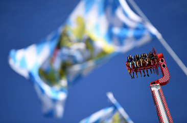 Visitors experience a thrill ride during Oktoberfest in Munich