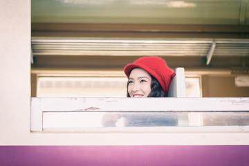 Asian woman traveler has exciting with traveling by train at Hua Lamphong station at Bangkok, Thailand.
