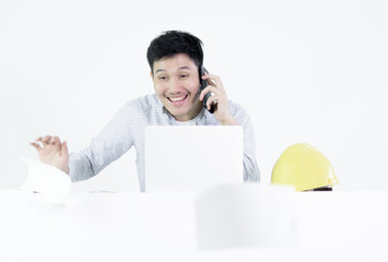 Asian employee engineer salary man sitting at desk throwing papers with feeling angry and upset, isolated on white background.