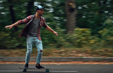 Young people skateboarding on road.