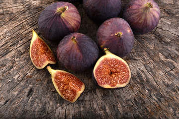 Figs on rustic wooden background.