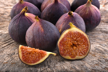 Figs, fruits on rustic wooden background.