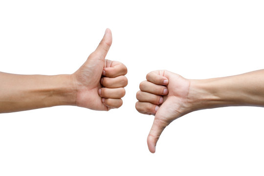 Thumbs up and thumbs down on white background