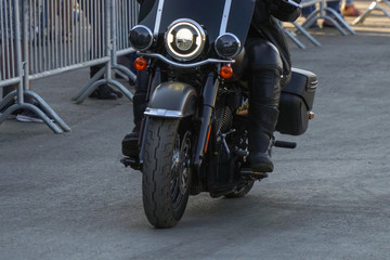 Biker in leather gear riding a motorcycle