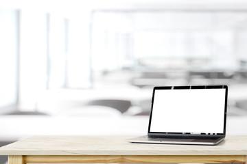 Workspace mockup blank screen laptop on marble desk table.