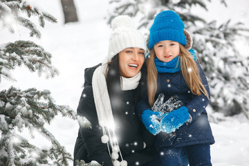Cheerful family sharing Christmas presents outdoors