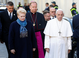 Pope Francis and Lithuanian President Grybauskaite arrive at the Memorial to the Holocaust victims, in Vilnius