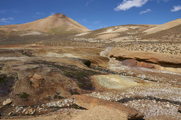 Parched river valley running through the colourful desert landscape in Lauca National Park on the altiplano of northern Chile