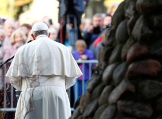 Pope Francis speaks next to a memorial at the Museum of Occupations and Freedom Fights, in Vilnius