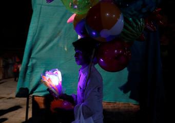 A street vendor sells toys during the Indra Jatra Festival in Kathmandu