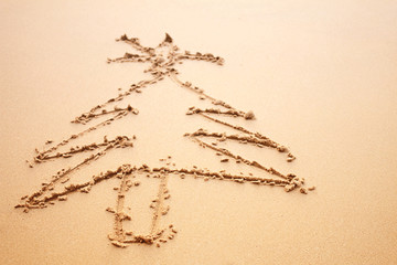 Christmas tree painted on the sand on the beach at Phuket Thailand