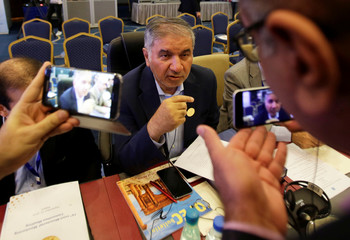 Iran's OPEC governor Hossein Kazempour Ardebili talks to the media at the OPEC Ministerial Monitoring Committee in Algiers