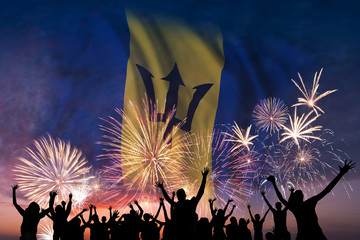 People are looking on fireworks and flag of Barbados