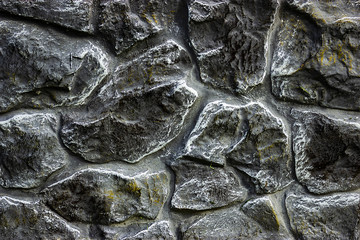 background of a wall with a stone