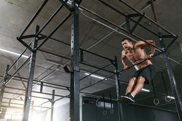 Training. Sports Man Doing Pull Ups Exercise On Sport Rack
