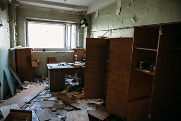 Haunted and abandoned room in ruined industrial building, creepy building interior without people