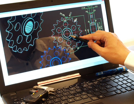 engineer working on computer at mechanical piece design cad blueprint