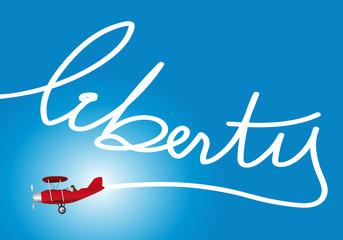 un avion inscrit dans le ciel le mot liberty