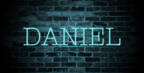 first name Daniel in blue neon on brick wall