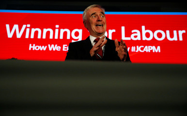 Britain's Labour Party shadow Chancellor of the Exchequer, John McDonnell speaks during a fringe meeting at his party's annual conference, in Liverpool