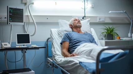 In the Hospital, Senior Patient Lying in Bed, Sleeping. Modern Hospital Geriatrics Ward.