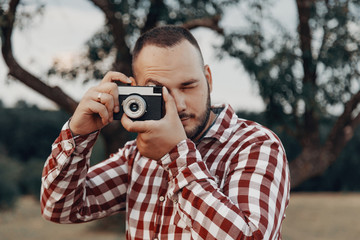 Portrait of a handsome bearded young man, taking pictures
