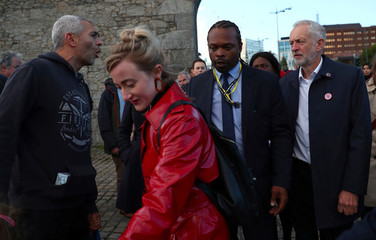 A man heckles Britain's Labour Party Leader Jeremy Corbyn as he leaves a vigil for peace in Yemen during the annual Labour Party Conference in Liverpool