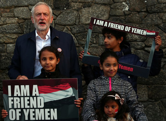 Britain's Labour Party Leader Jeremy Corbyn poses for photographers at a vigil for peace in Yemen during the annual Labour Party Conference in Liverpool