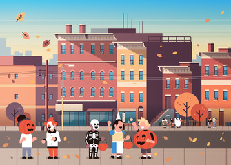 kids wearing monsters costumes walking town holiday concept cityscape background tricks or treat happy halloween cartoon character full length horizontal flat vector illustration