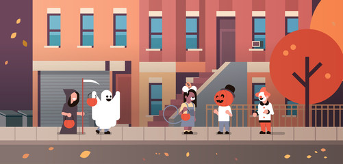 kids wearing monsters ghost pumpkin wizard clown costumes walking town holiday concept tricks or treat happy halloween cartoon character full length horizontal flat vector illustration