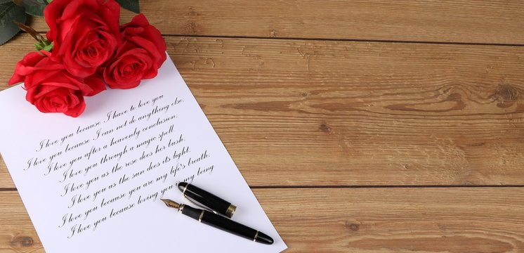 handwritten letter with a declaration of love with red roses on a wooden table - valentines day - marriage proposal - i love you