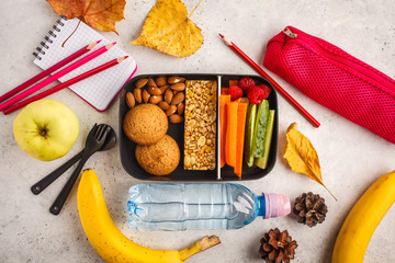 School flat lay. Healthy meal prep containers with fruits, berries, snacks and vegetables. Takeaway food on white background, top view.