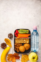 Foto op Canvas Assortiment Healthy meal prep containers with cereal bar, fruits, vegetables and snacks. Takeaway food on white background, top view.
